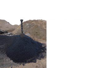 Scoop in Pile Asphalt
